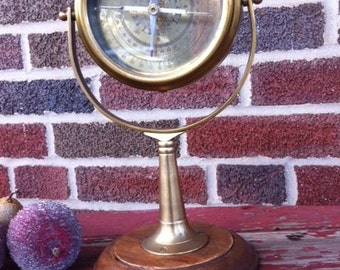 vintage brass and wood standing compass