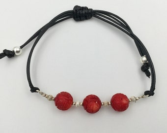 Bracelet in silver and coral bamboo carving