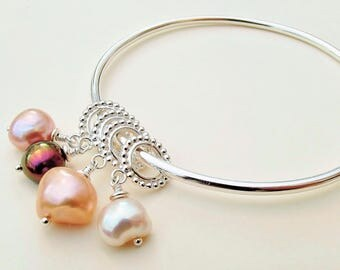 Handmade silver bangle with freshwater pearls