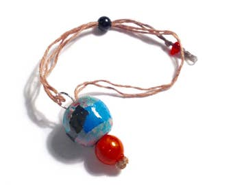 Bracelet: woven hemp with hand-painted beads