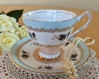 Elizabethan by Taylor & Kent Teacup and Saucer, Pink, White and Blue with Rose Buds, Gold Trim, Bone China - c. 1961+