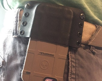 Magpul phone case holster (magpul case not included).