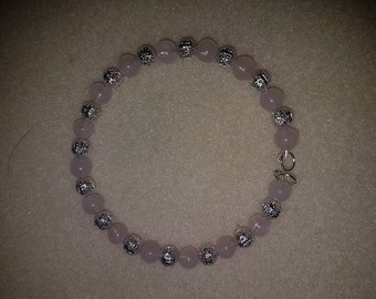 Pink semi precious beads and silver plated hollow beads bracelet
