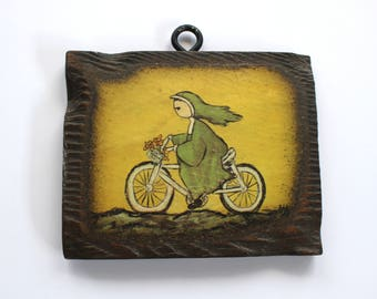 Vintage Nun on a Bicycle Wood Plaque