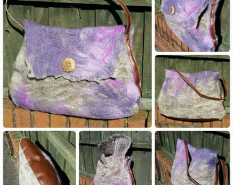 Large wet felted shoulder bag. Natural grey with purple and lilac. Faux leather strap and base.