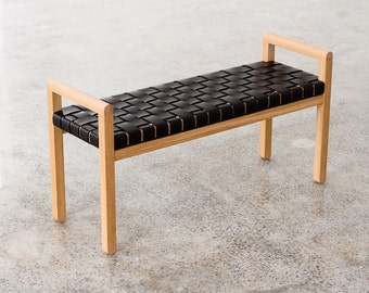 Elegant modern wood-framed bench with woven leather seat