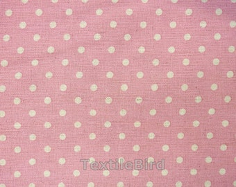 Nature polka dots on pink base colour - 150 cm wide