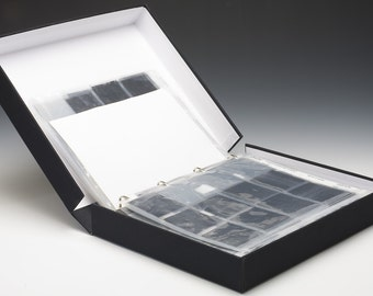 The storage box of negatives, with framed store rings.