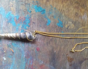 Under the Sea. A simple shell and pearl pendant on a long chain.Original