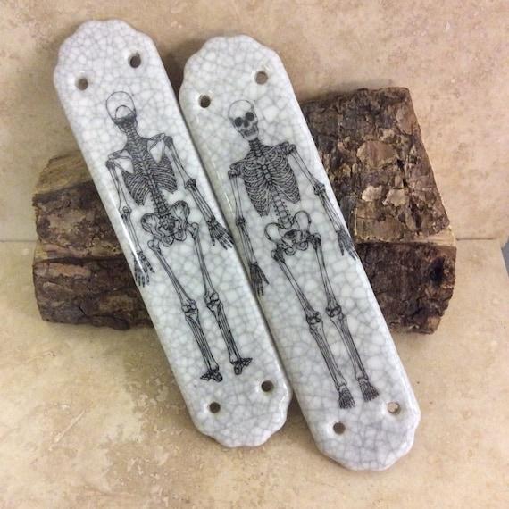 pair of ceramic skeleton door finger plates from. Black Bedroom Furniture Sets. Home Design Ideas