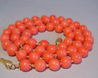 Long coral necklace with natural coral beads with gold plated silver highlights