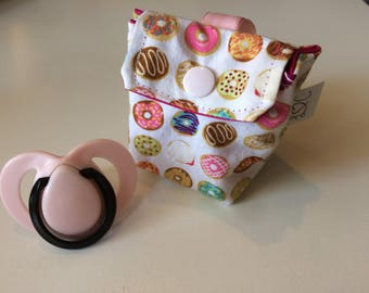 Bag has pacifier / donut