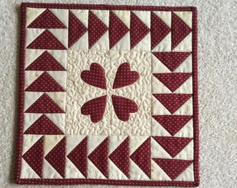 Red heart quilted small table topper