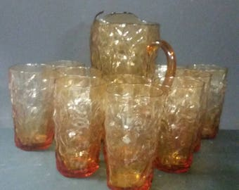 Vintage amber glass pitcher and 10 matching glasses