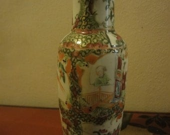 Chinese Vase with floral panels  height =13cm