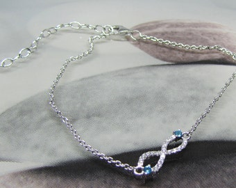 Infinity 925 sterling silver and oxide of Zirconium white and blue bracelet. 25% with code: SOLD17