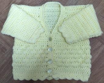 Printed DK Crochet Pattern For V Neck Cardigan. Sizes: Birth to 6 years (1002)