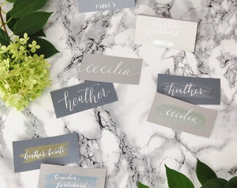 custom calligraphy escort cards | hand lettered | wedding place holders | event name cards