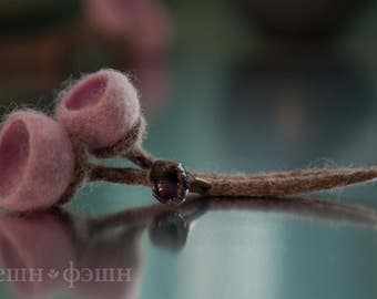 This outstanding brooch made from felted wool and handmade glass (lampwork)