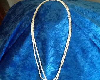 Silver toned two strand chain necklace.