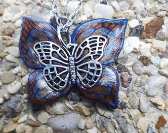 Blue, gold, copper and silver Butterfly Fimo necklace.