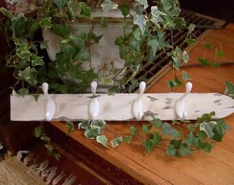 White picket fence coat rack