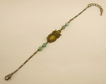 Blue OWL band in bronze metal and glass diamond beads