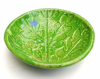 A Green oval ceramic / pottery bowl with nature inspired decoration perfect as a trinket dish, prep bowl, home decor