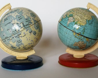 A pair of Chad Valley tin plate lithographed globes. 1970