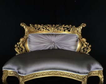 French Settee in antique gold leaf, hand carved from solid wood and pleated lavender silk