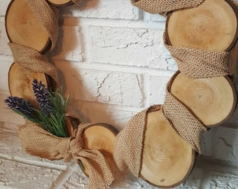 Wood slice wreath with burlap and lavender sprigs. Country decor