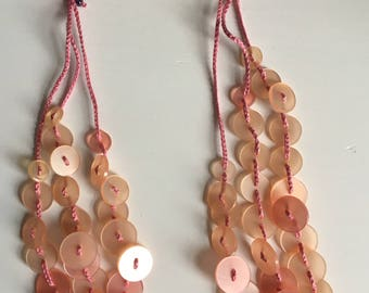 Pink crochet necklace with buttons