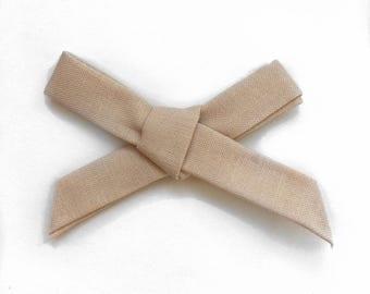 The Starlet Bow, Tan