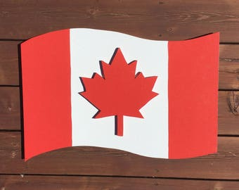 "Handcrafted Wooden Canadian Flag w/ design on 2 Sides   24"" x 15"""