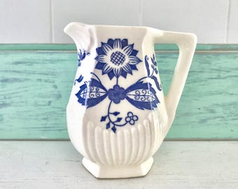 Dainty vintage delft blue creamer with blue flowers