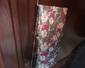 Portable, lightweight holder for a clutch purse