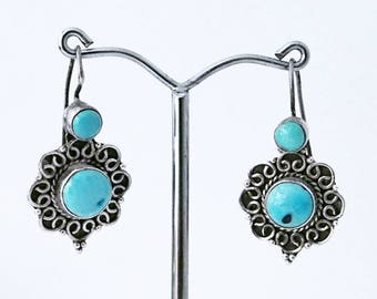 Silver earrings and turquoise stones