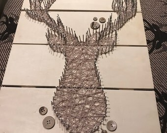 Nailed stagg wall decor