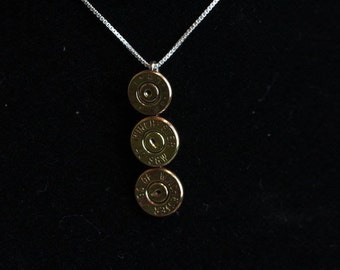 Three bullet end necklace