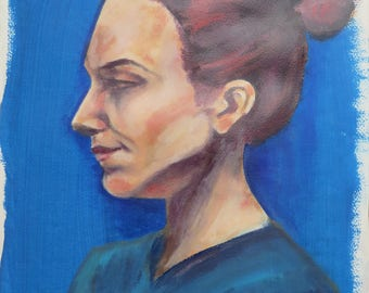 Side profile painting of a woman from a life model, blue background