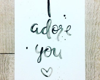 Handwritten 'I Adore You' artwork
