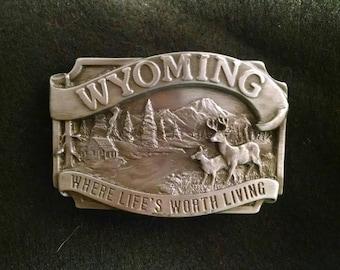 Siskiyou 1983 Wyoming Belt Buckle, Deer, Cabin, Where Life's Worth Living