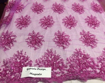 Magenta gaviota design embroider and beaded on a mesh lace. Wedding/Bridal/Nightgown/Prom Fabric. Sold by the yard.
