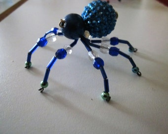 1 Blue  Beaded Spider with green and clear legs..Sun Catcher