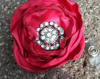 Red rosette badge reel