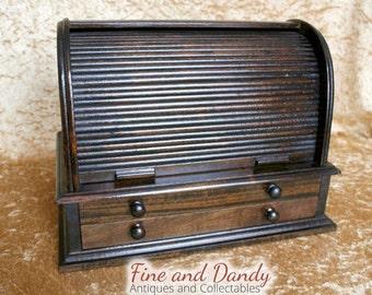 An Oak Roll Top Desktop stationery box.