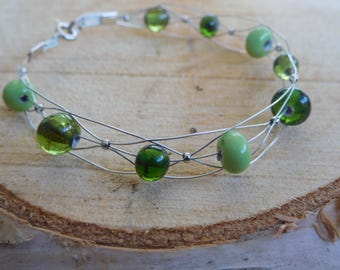 Bracelet with handmade beads in shades of green