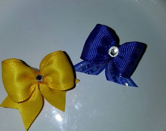 5/8 puppy bows perfect for pig tails! They can come in all colors! Order your today!
