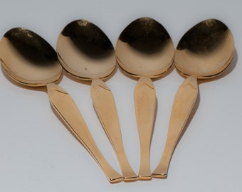 Gold finish Stanley Roberts stainless steel set of 4 spoons