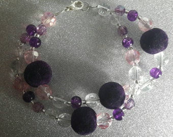 Purple and clear bead bracelet